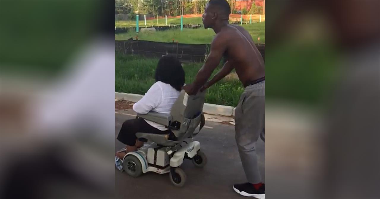 Man+Pushes+Woman+Home+When+Wheelchair+Breaks