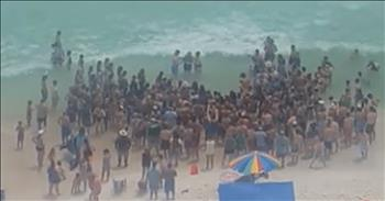 Baptism On The Beach Draws Crowd And Cheers