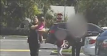 Dash Cam Shows Police Officer Saving Girl From Hot Car