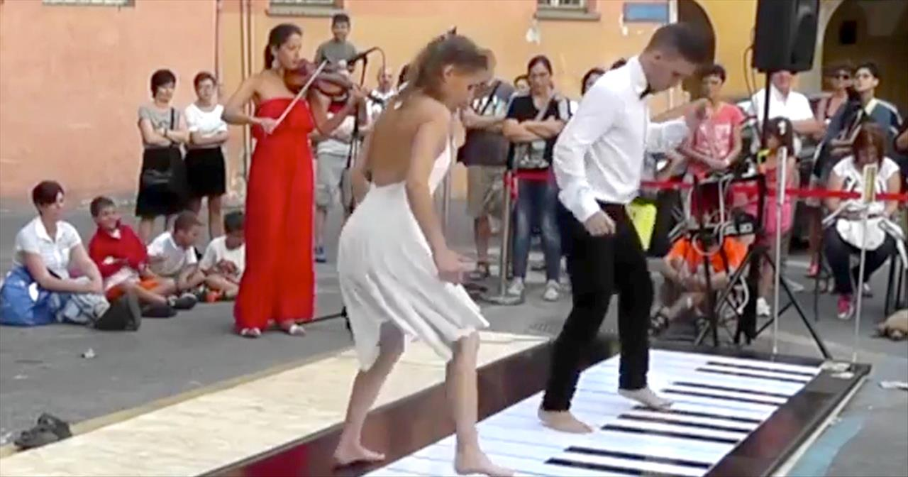 Couple Plays Floor Piano with Synchronized Dance - Staff Picks