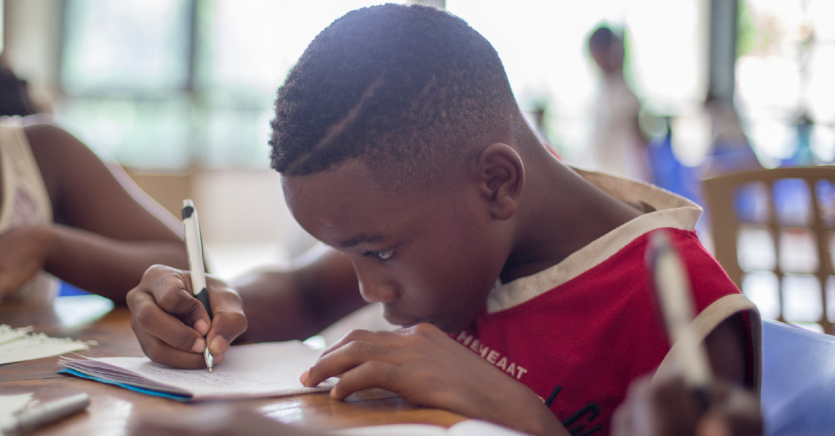 young boy working on homework
