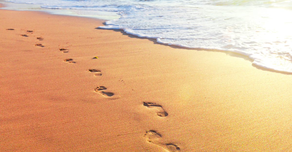 """Footprints in the Sand"" Poem Meaning & Biblical Hope"