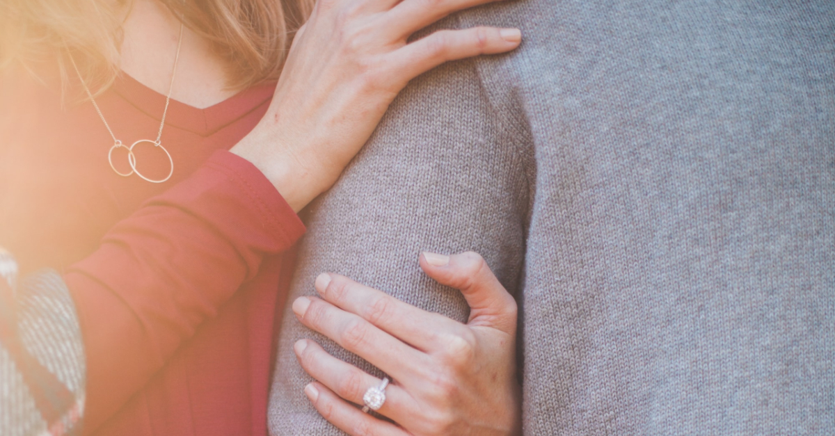 couple hugging with wedding ring