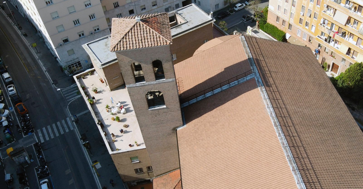 the rooftop of Santa Emerenziana church, religious services are still restricted in Italy despite other places begin to reopen