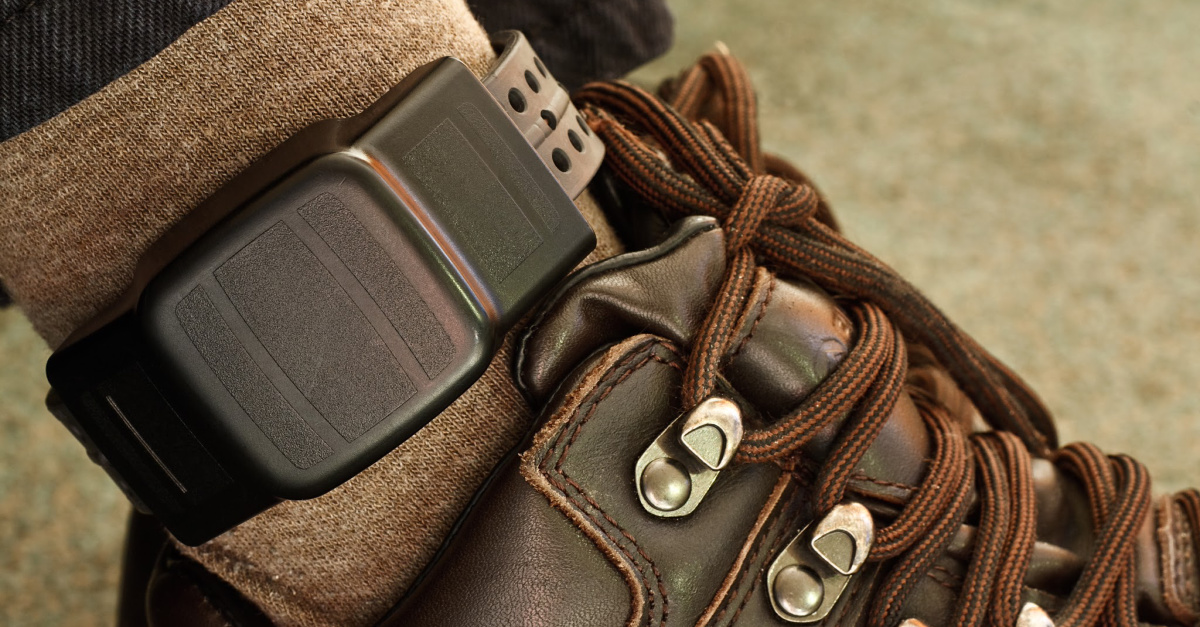 An ankle monitor, pastor is placed under house arrest