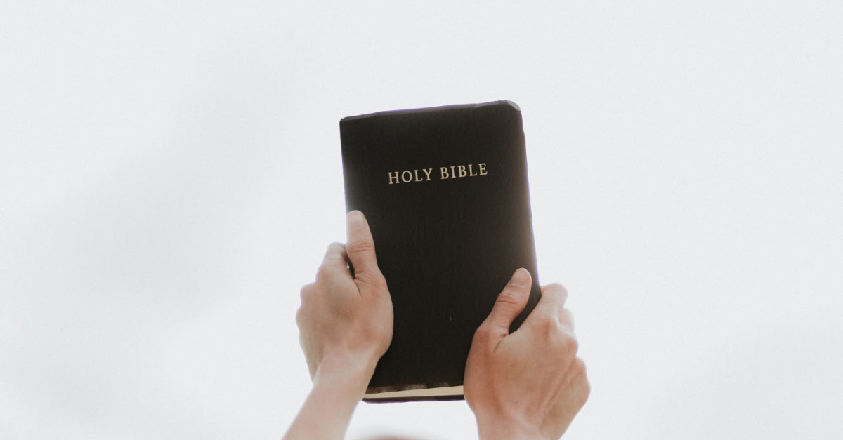 a bible, surprising someone with God's compassion