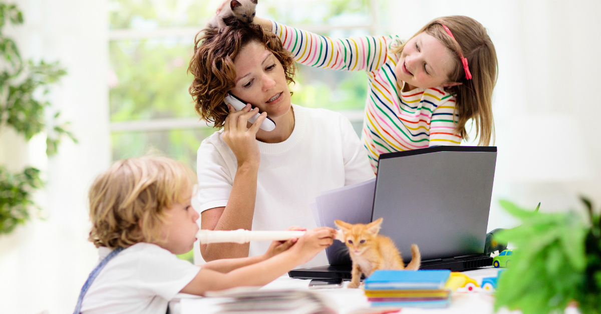 busy mom working from home with kids