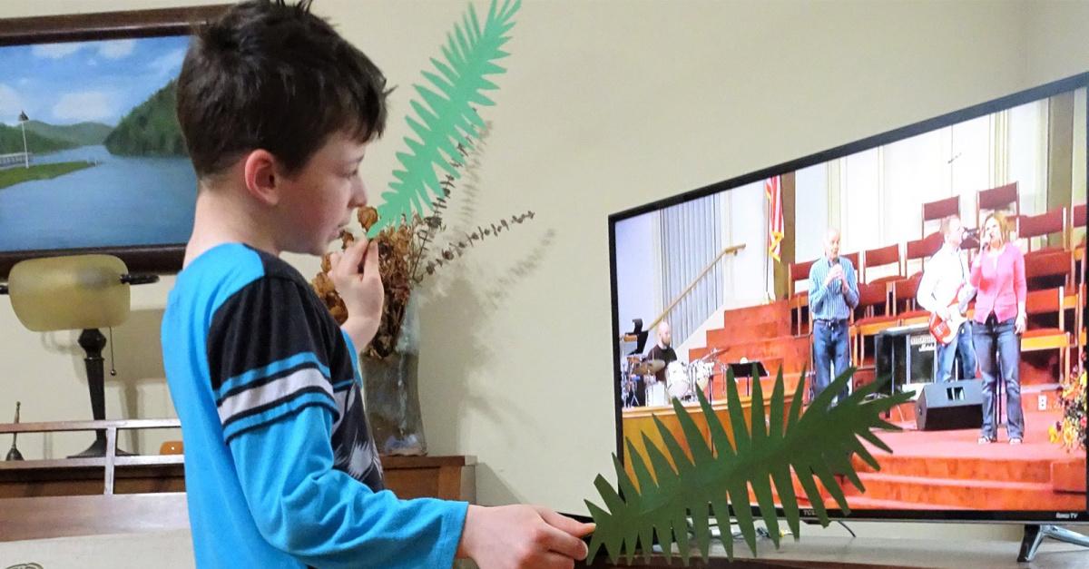 A kid watching virtual Sunday school, churches bring Sunday school home