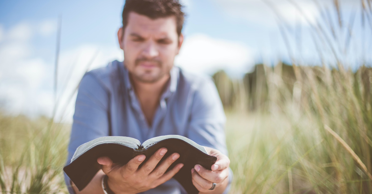 A man reading a Bible, We need to show faith leaders that they have a support system