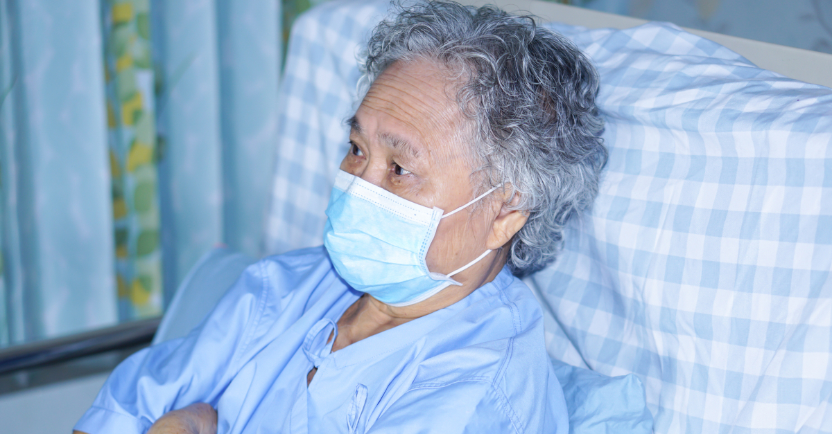 senior asian woman in hospital bed coronavirus