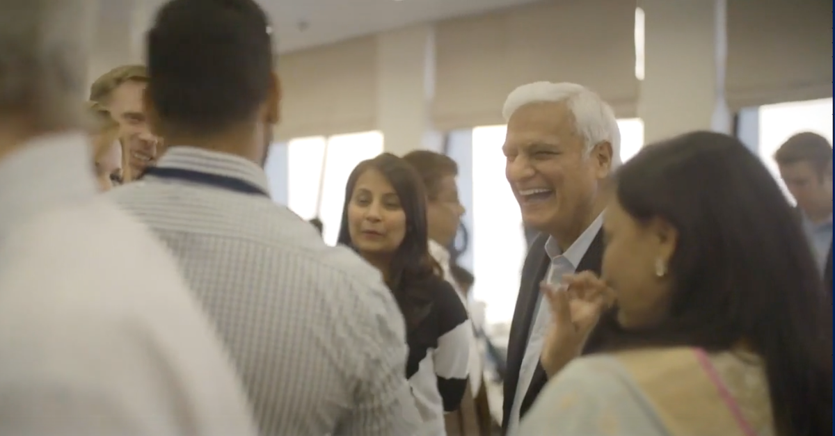 Ravi Zacharias with a group of people