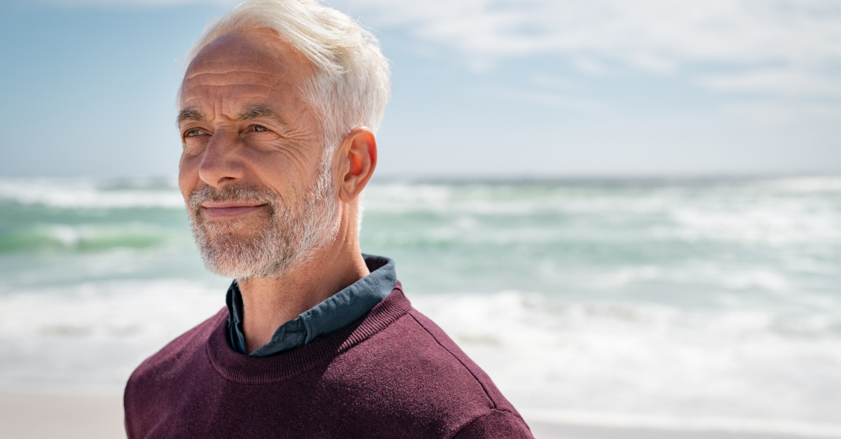senior man looking thinking at beach