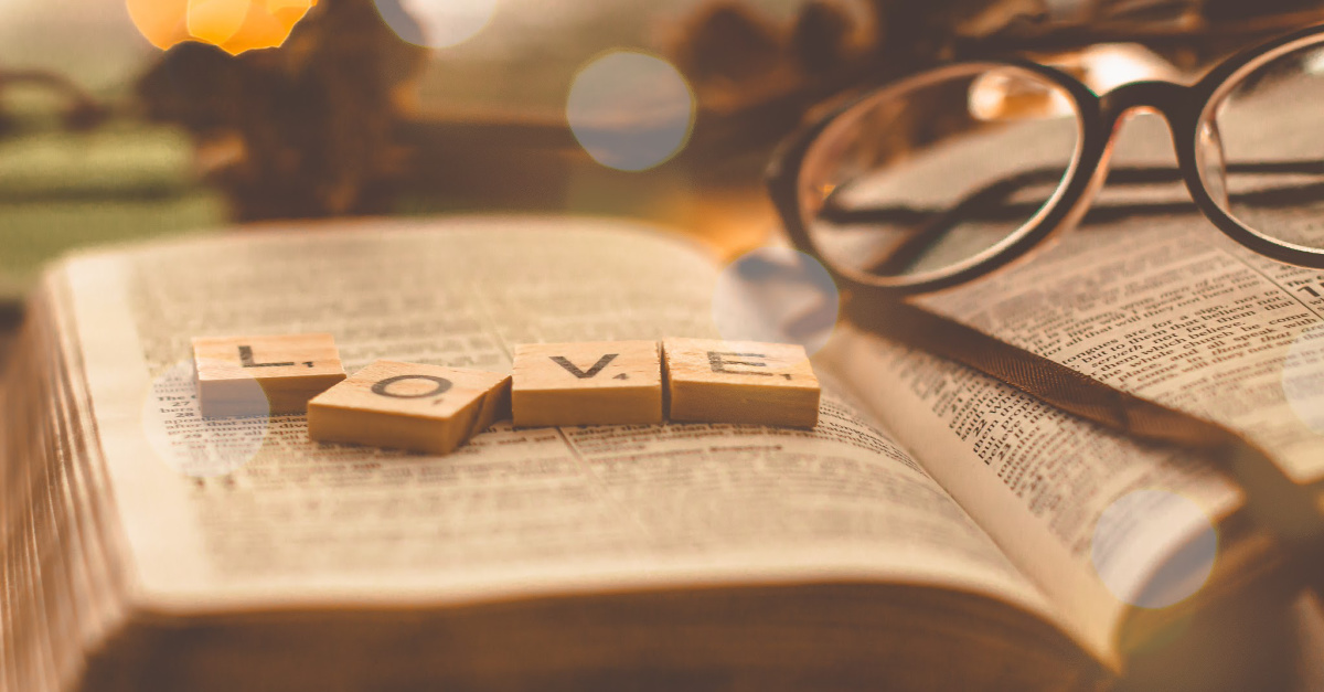 Love scrabble pieces on a Bible, hallmark movies lgbtq