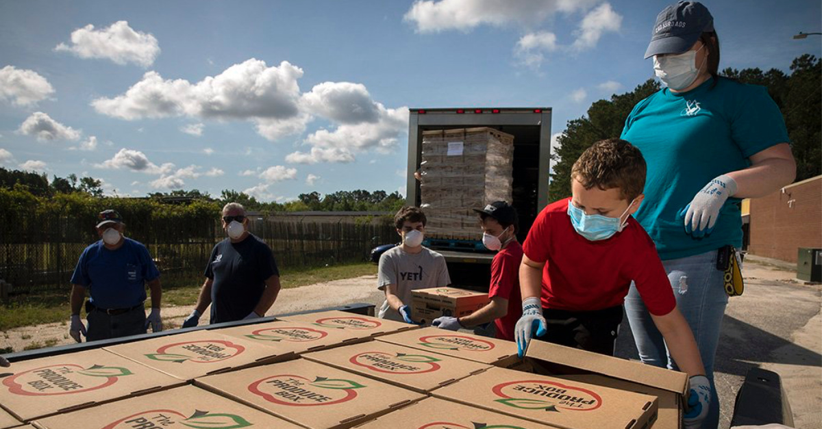 Baptist on Mission group, Baptist on Mission distribute food boxes