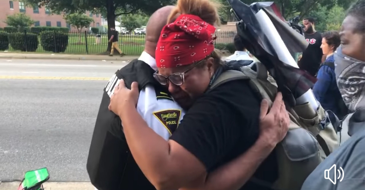 Fayetteville Police Hugging protesters, Police across the country kneel in solidarity with cops