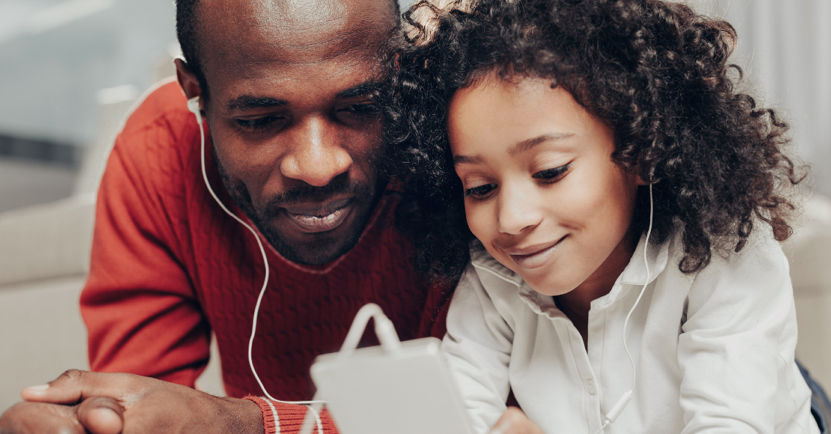 dad and kid listening to music