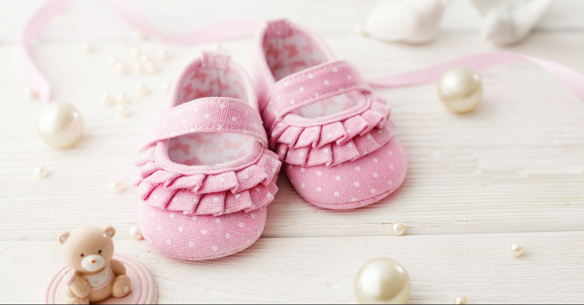 Pink baby shoes and pearls