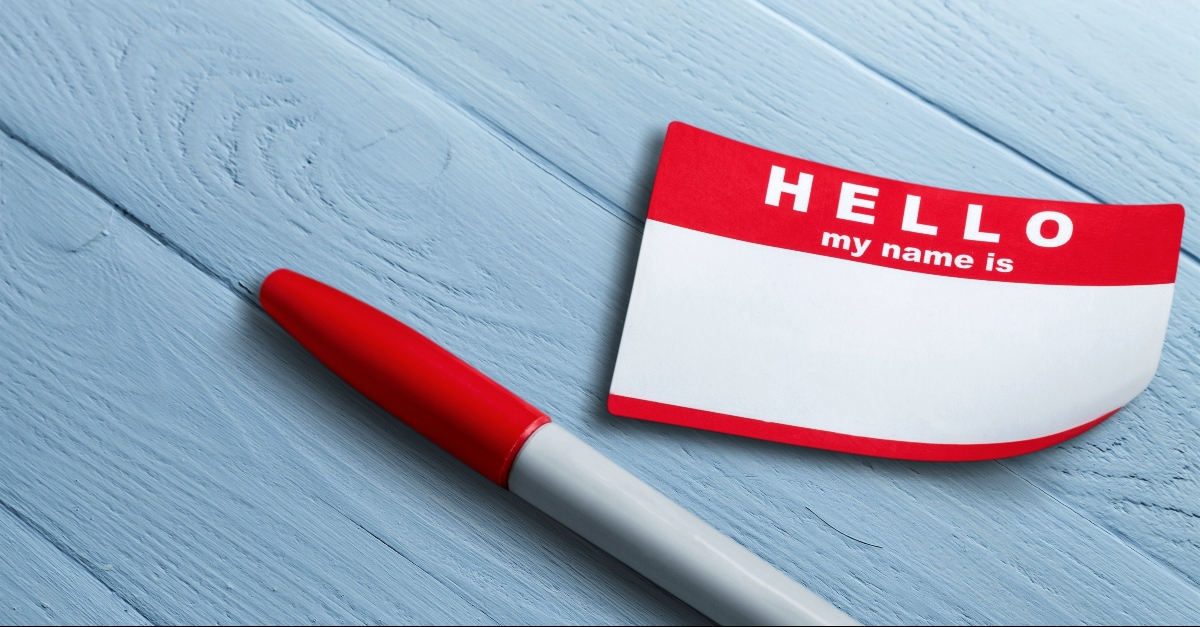 Hello My Name is name tag and red pen