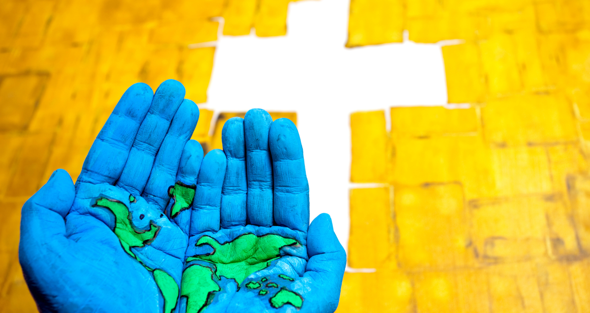 palms painted like globe with cross on street healing racism