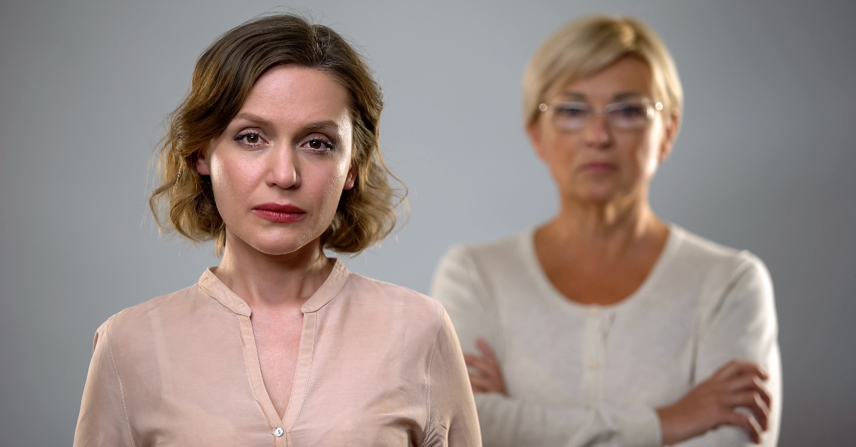 two women looking serious and angry standing apart