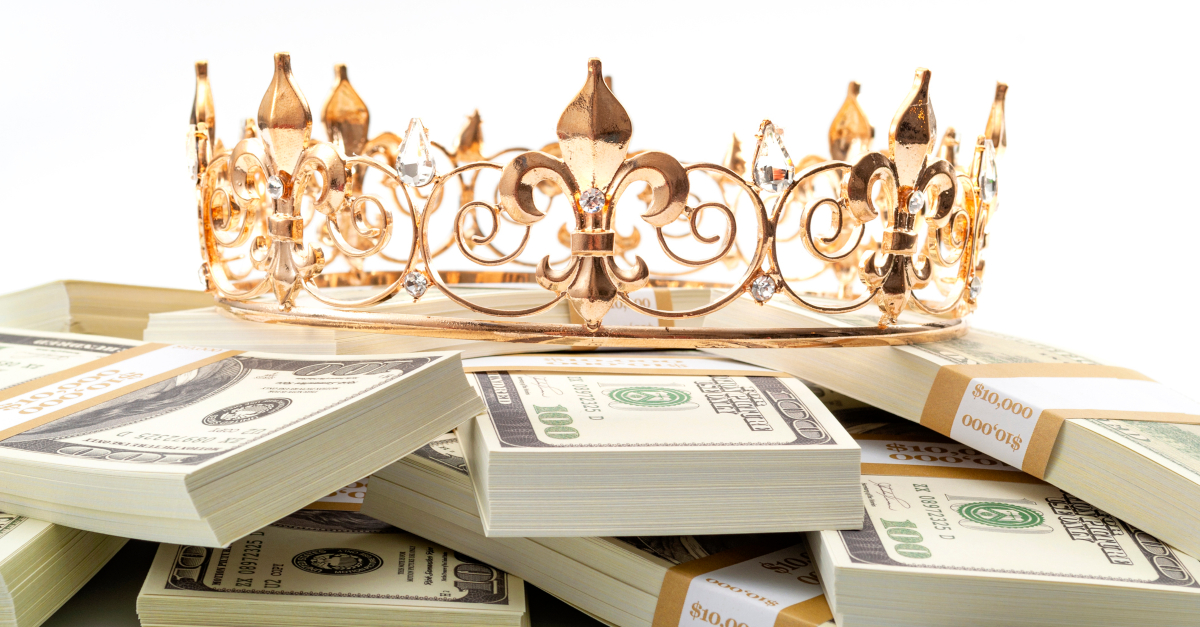 stacks of money with crown on top god of money