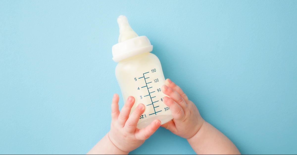 Baby bottle and hands