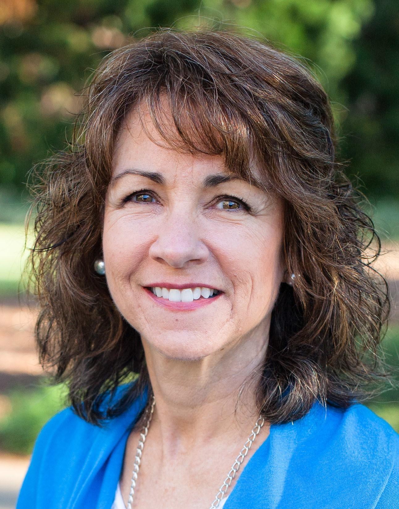 headshot for author Lori Hatcher