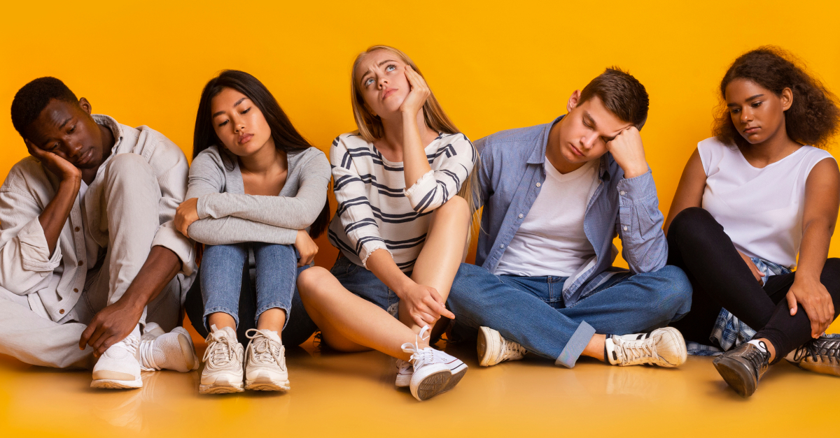 group of multicultural teens bored and disinterested youth group