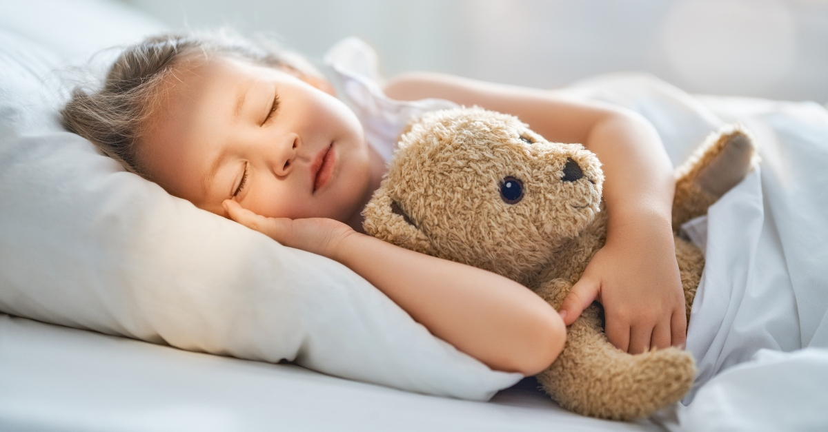 little girl sleeping peacefully in bed with teddy bear, now i lay me down to sleep