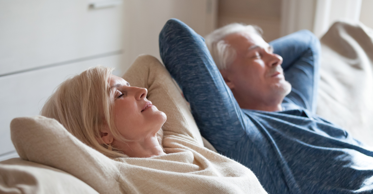 senior couple relaxing on couch happy joyful at peace