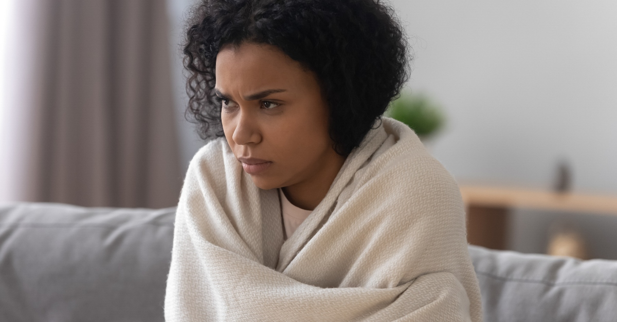 woman wrapped in blanket looking sad and grumpy and serious, what to do when disappointed in life