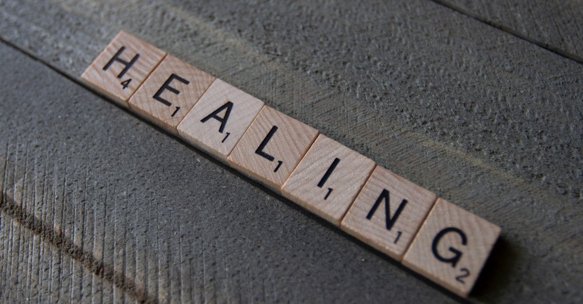scrabble tiles spelling the word healing