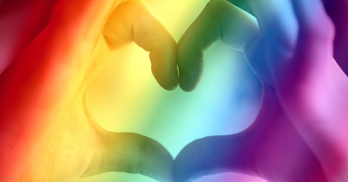 hands forming heart cast in rainbow lights gay marriage, hallmark movies lgbtq