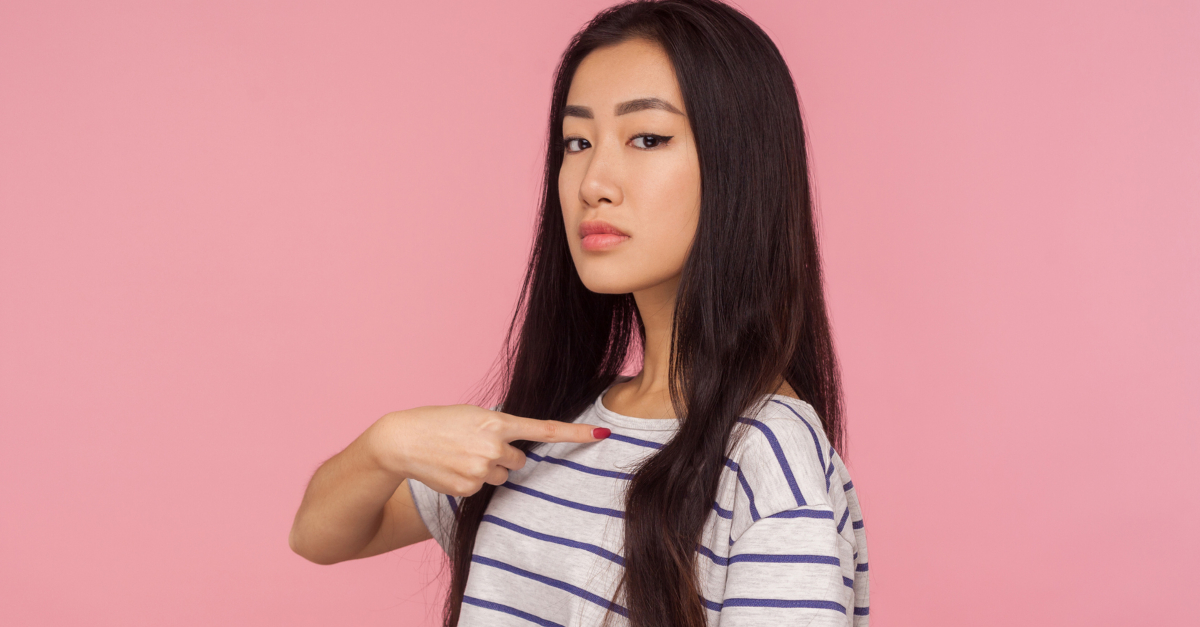 asian woman pointing to self conceit