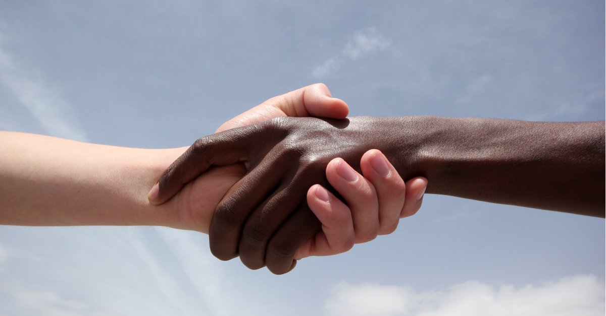 Black and White people shaking hands, The descendant of slaves and the descendant of slave owners push for racial reconciliation