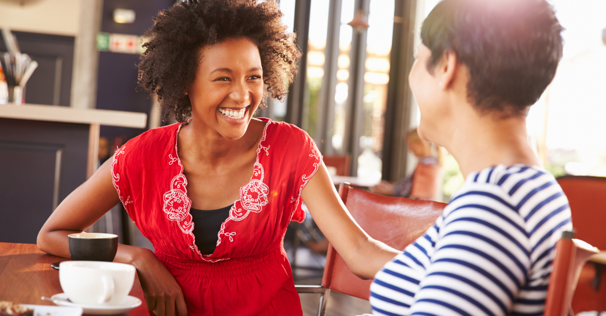 two women friends conversation over coffee, church speak love black brothers and sisters