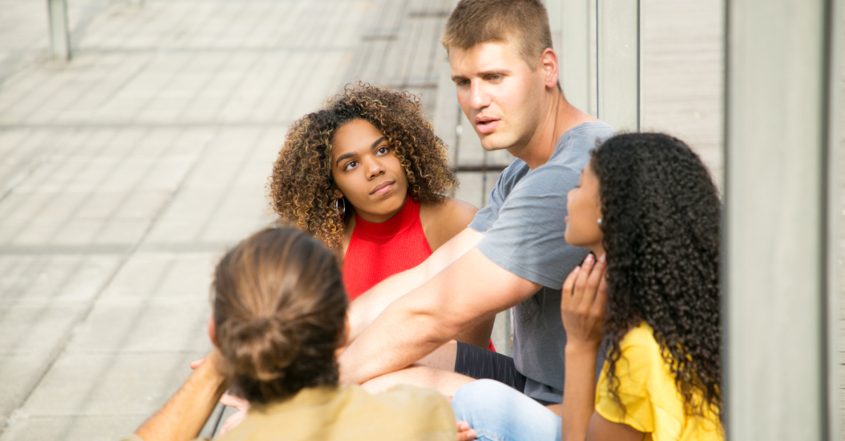 group of friends having serious discussion conversation