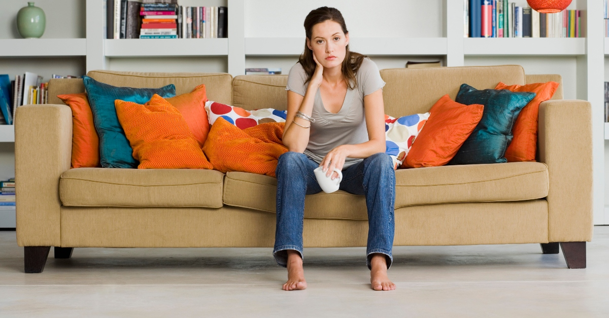 woman looking bored or thinking deeply on couch, bad habits distancing you from God