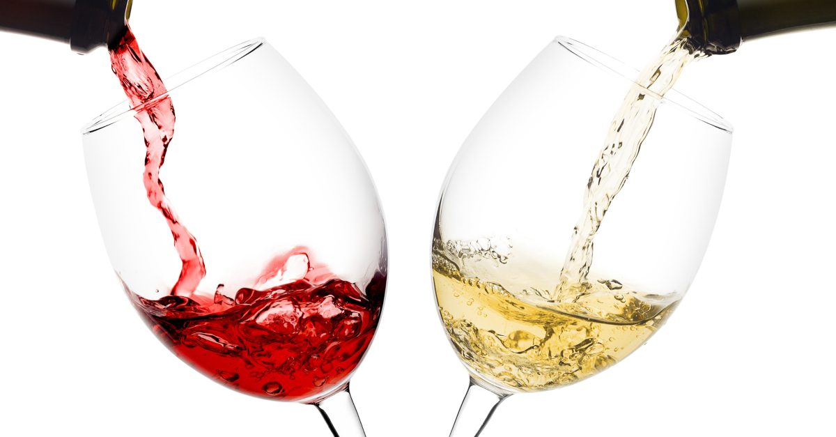 two glasses of alcohol red and white wine being poured