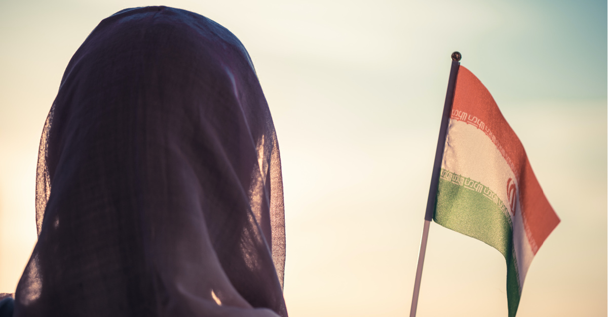 A woman with an Iranian flag, Thousands convert to Christianity in Iran despite oppressive government