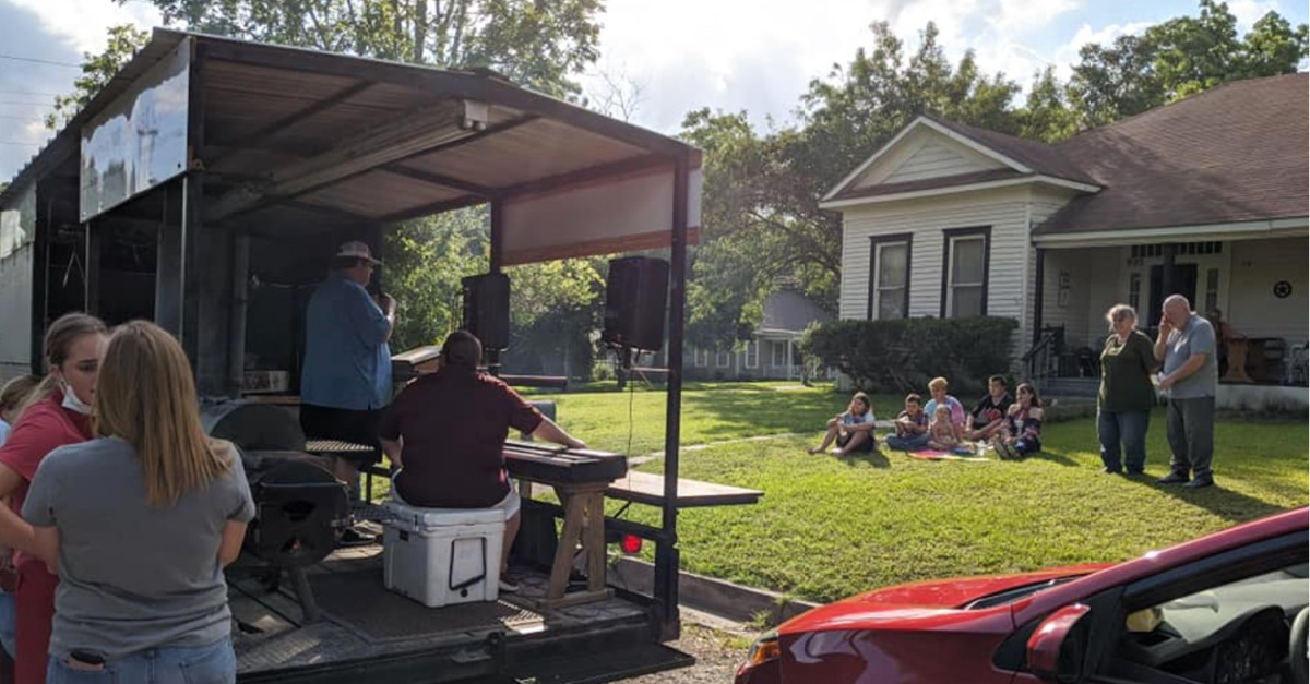 A mobile worship service and meal truck, BBQ Baptist church delivers meals and worship amid the pandemic