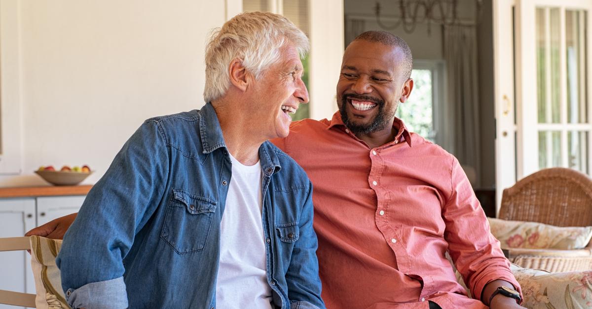 two men having a conversation smiling