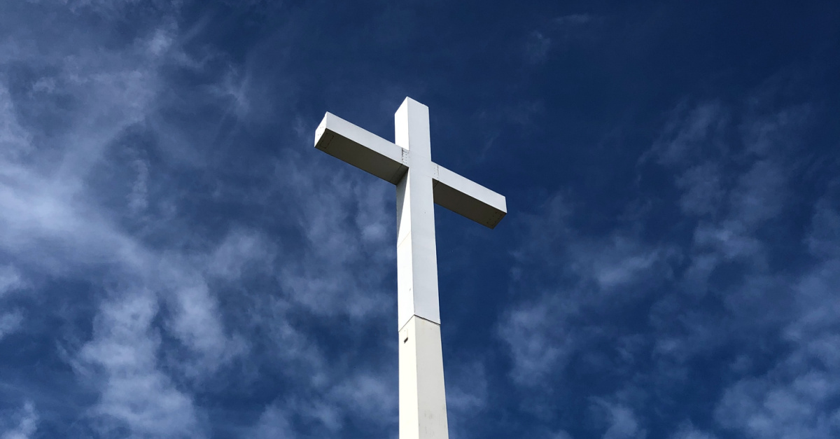 A white cross, Antifa moves to tear down a cross on a Christian college campus