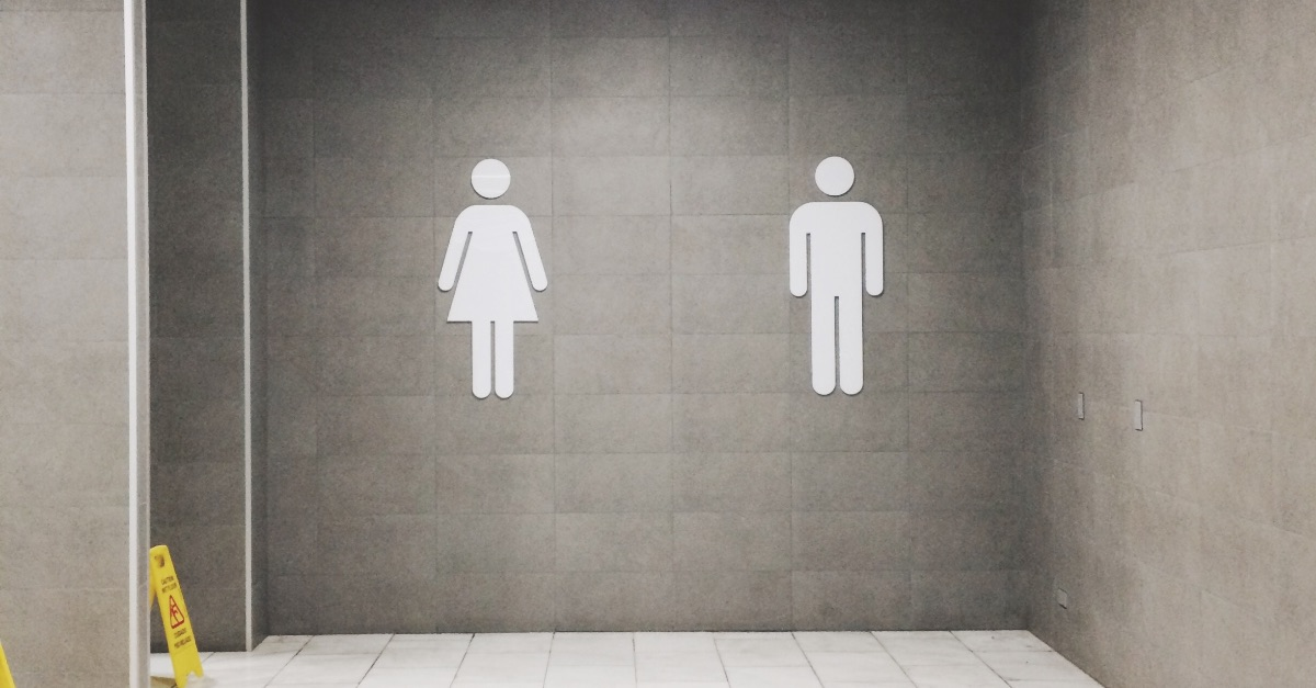Male and female bathroom signs, Appeals court rules that schools cannot require students to use certain restrooms based on their biological sex