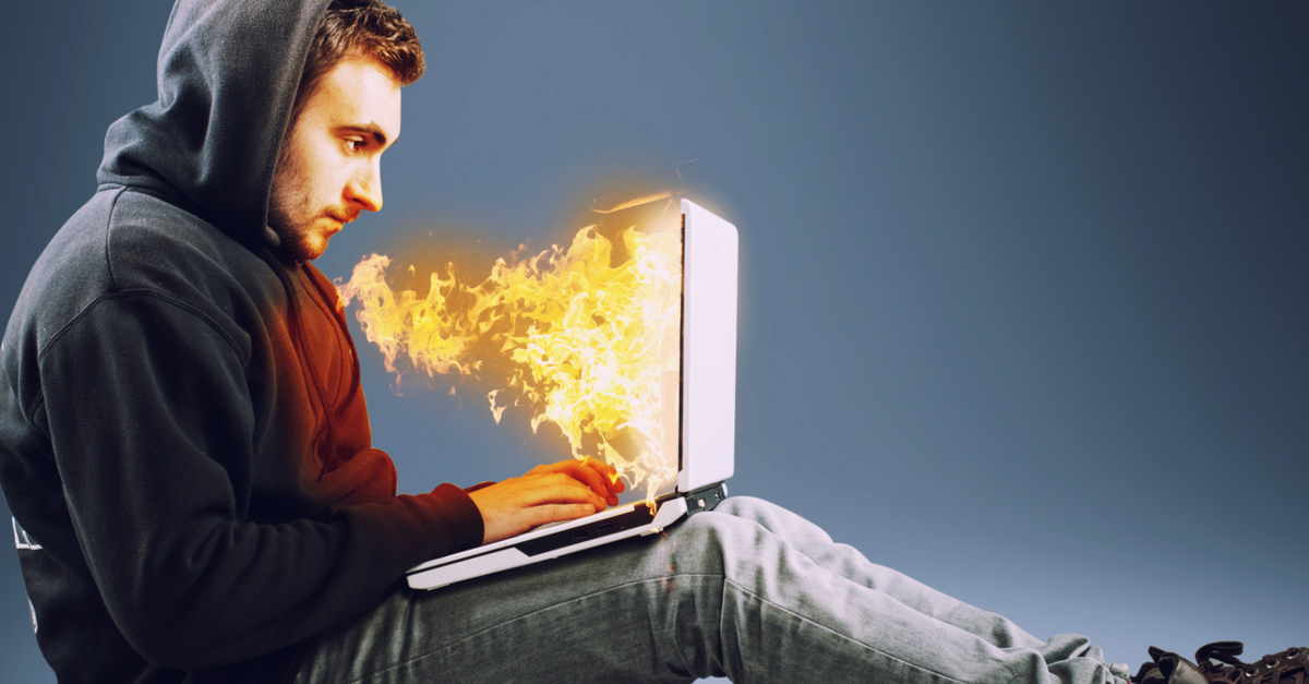 man with laptop on fire satan deceiving through social media