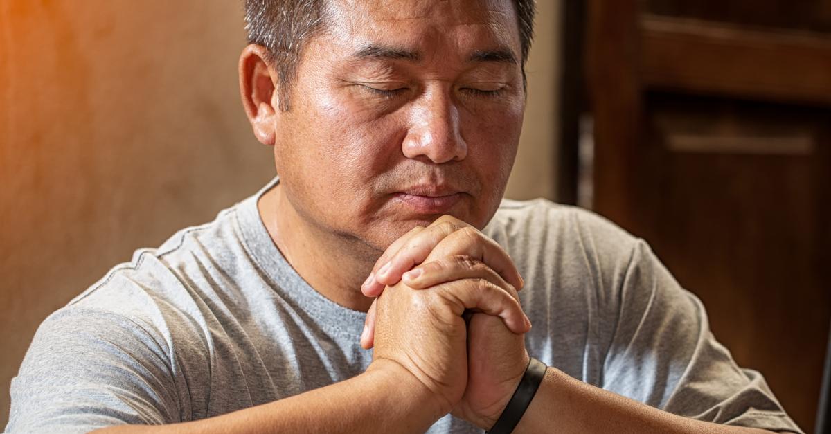 man praying eyes closed Adonai