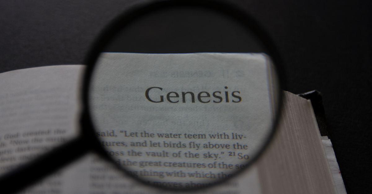 Bible open to book of Genesis with magnifying glass to signify apple of my eye