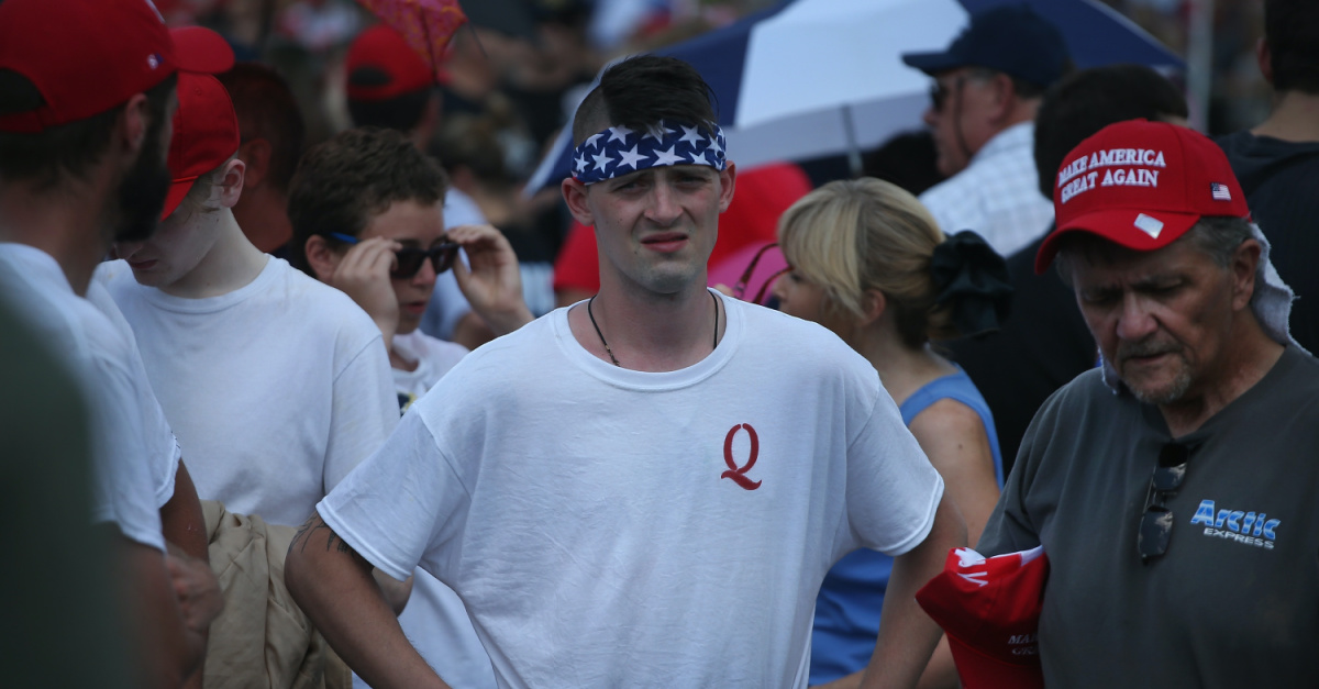 Man in a QAnon shirt, A growing number of political leaders have warned about the Influence of QAnon