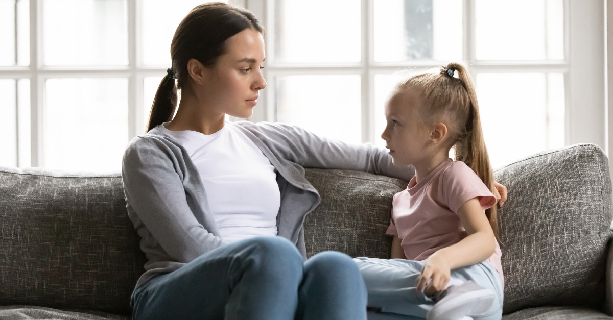 mom having serious conversation with her daughter, fear harms child's faith