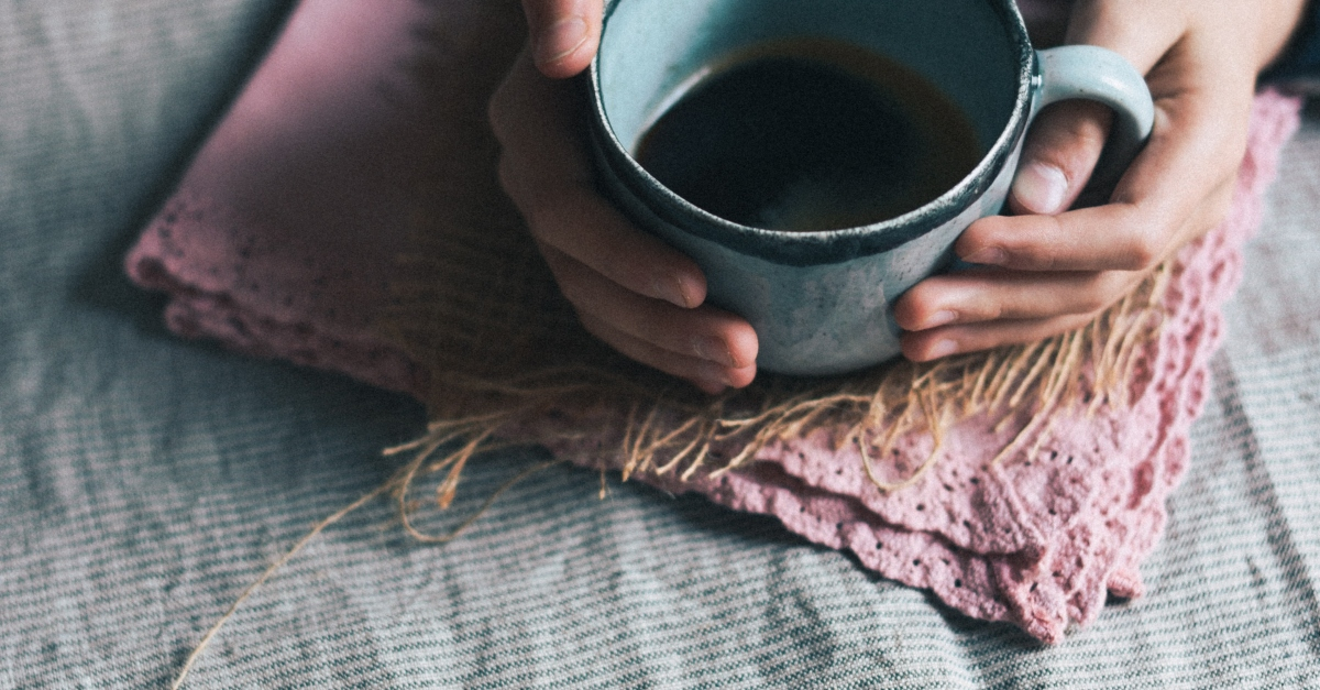 woman's hands holding cup of coffee, prayer for new purpose new day